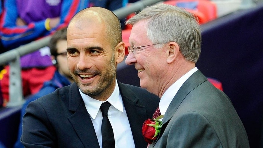 Barcelona's Spanish coach Josep Guardiola (L) embraces Manchester United manager Alex Ferguson during the UEFA Champions League final football match FC Barcelona vs. Manchester United, on May 28, 2011 at Wembley stadium in London. AFP PHOTO / CARL DE SOUZA (Photo credit should read CARL DE SOUZA/AFP/Getty Images)