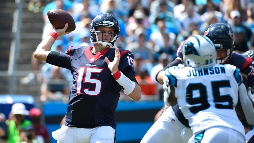 Sep 20, 2015; Charlotte, NC, USA; Houston Texans quarterback Ryan Mallett (15) looks to pass as Carolina Panthers defensive end Charles Johnson (95) defends in the first quarter at Bank of America Stadium. Mandatory Credit: Bob Donnan-USA TODAY Sports