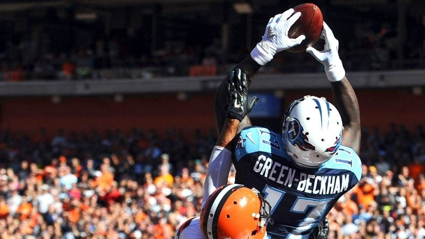 Sep 20, 2015; Cleveland, OH, USA; Tennessee Titans wide receiver Dorial Green-Beckham (17) catches a fourth quarter touchdown over Cleveland Browns cornerback Joe Haden (23) at FirstEnergy Stadium. The Browns won 28-14. Mandatory Credit: Ken Blaze-USA TODAY Sports