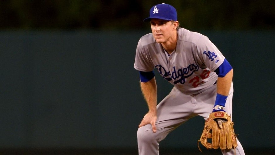 ANAHEIM, CA - SEPTEMBER 8: Chase Utley #26 of the Los Angeles Dodgers plays third base during the ninth inning of the game against the Los Angeles Angels of Anaheim at Angel Stadium of Anaheim on September 8, 2015 in Anaheim, California. (Photo by Matt Brown/Angels Baseball LP/Getty Images)