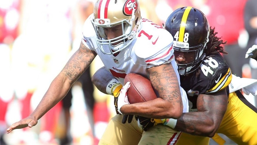 Sep 20, 2015; Pittsburgh, PA, USA; San Francisco 49ers quarterback Colin Kaepernick (7) is sacked by Pittsburgh Steelers linebacker Bud Dupree (48) during the fourth quarter at Heinz Field. The Steelers won 43-18. Mandatory Credit: Charles LeClaire-USA TODAY Sports