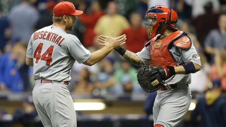 MILWAUKEE, WI - SEPTEMBER 16: Trevor Rosenthal #44 of the St. Louis Cardinals celebrates with Yaider Molina #4 after the 5-4 win over the Milwaukee Brewers at Miller Park on September 16, 2015 in Milwaukee, Wisconsin. (Photo by Mike McGinnis/Getty Images)
