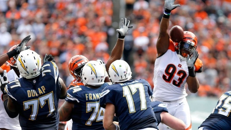 Sep 20, 2015; Cincinnati, OH, USA; Cincinnati Bengals defensive end Will Clarke (93) knocks down a pass from San Diego Chargers quarterback Philip Rivers (17) in the second half at Paul Brown Stadium. The Bengals won 24-19. Mandatory Credit: Aaron Doster-USA TODAY Sports