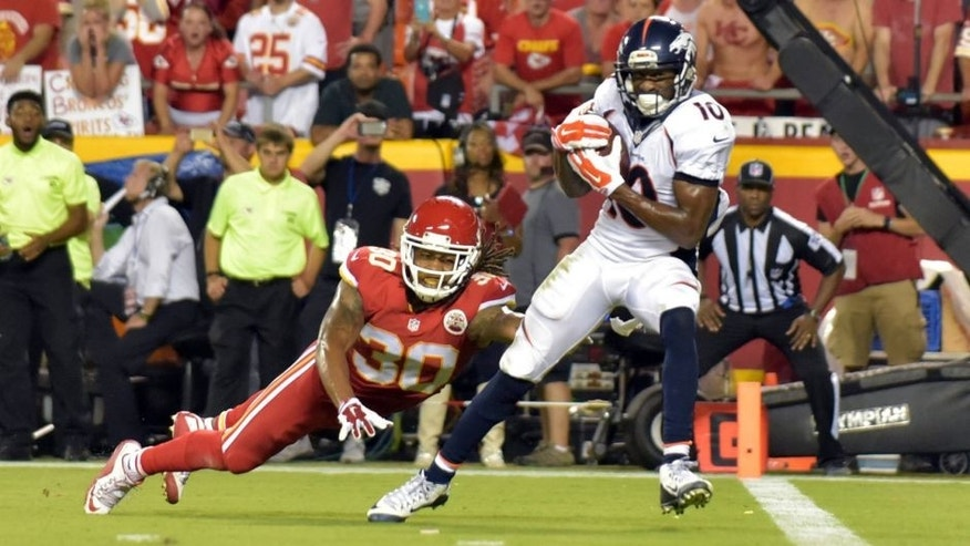 Sep 17, 2015; Kansas City, MO, USA; Denver Broncos wide receiver Emmanuel Sanders (10) catches a pass and scores a touchdown as Kansas City Chiefs cornerback Jamell Fleming (30) tries to defend during the second half at Arrowhead Stadium. The Broncos won 31-24. Mandatory Credit: Denny Medley-USA TODAY Sports