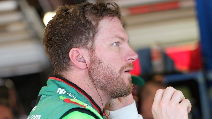 Dale Earnhardt Jr, driver of the #88 DIET MOUNTAIN DEW Chevrolet, stands in the garage area during practice for the NASCAR Sprint Cup Series myAFibRisk.com 400 at Chicagoland Speedway on September 18, 2015 in Joliet, Illinois. (Photo by Matt Sullivan/Getty Images)