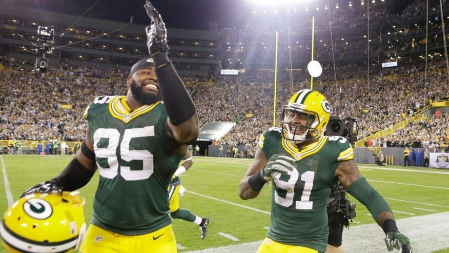 <p>Green Bay Packers' Jayrone Elliott (91) and Datone Jones celebrate during the second half of an NFL football game against the Seattle Seahawks Sunday, Sept. 20, 2015, in Green Bay, Wis. The Packers won 27-17. (AP Photo/Jeffrey Phelps)</p>