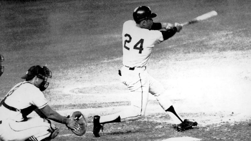American baseball player Willie Mays (#24, right) of the San Francisco Giants hits the ball that become his 600th career home run during a game against the San Diego Padres at the Jack Murphy Stadium (later Qualcomm Stadium), San Diego, California, September 22, 1969. Padres's catcher Chris Cannizzaro (#8) is at left. (Photo by Bruce Bennett Studios/Getty Images)