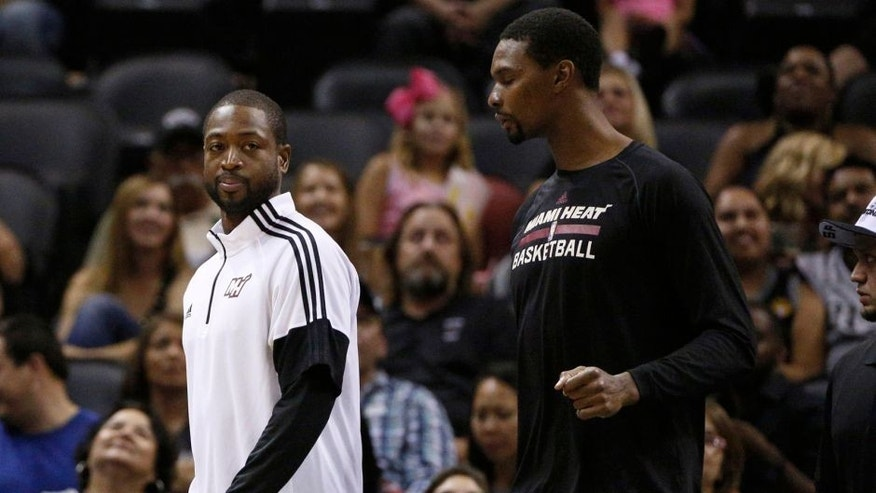 Oct 18, 2014; San Antonio, TX, USA; Miami Heat shooting guard Dwyane Wade (3) and power forward Chris Bosh (1) walk onto the court during the second half against the San Antonio Spurs at AT&T Center. The Heat won 111-108 in overtime. Mandatory Credit: Soobum Im-USA TODAY Sports