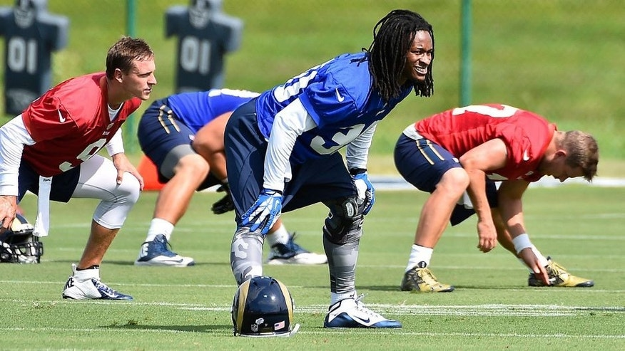 Aug 1, 2015; Earth City, MO, USA; St. Louis Rams running back Todd Gurley (30) stretches at Rams Park. Mandatory Credit: Jasen Vinlove-USA TODAY Sports