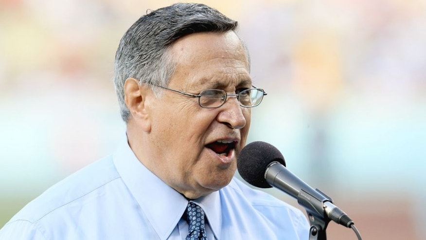 "LOS ANGELES, CA - JUNE 11: Los Angeles Dodgers Spanish language broadcaster Jaime Jarrin gives the ""It's time for Dodger Baseball"" call before the game against the Los Angeles Angels of Anaheim on June 11, 2012 at Dodger Stadium in Los Angeles, California. Jarrin was honored for his fifty four years on the job. (Photo by Stephen Dunn/Getty Images)"