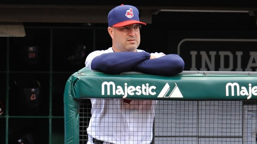 Sep 20, 2012; Cleveland, OH, USA; Cleveland Indians manager Manny Acta (11) stands in the dugout in a game against the Minnesota Twins at Progressive Field. Cleveland won 4-3. Mandatory Credit: David Richard-USA TODAY Sports