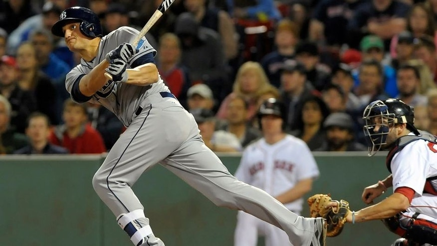 Sep 22, 2015; Boston, MA, USA; Tampa Bay Rays center fielder Mikie Mahtook (27) hits a two run home run during the eighth inning against the Boston Red Sox at Fenway Park. Mandatory Credit: Bob DeChiara-USA TODAY Sports