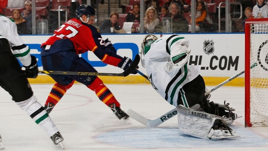 Dallas Stars goaltender Jack Campbell (1) makes a diving save against Florida Panthers forward Nick Bjugstad (27) during the second period of an NHL preseason hockey game, Tuesday, Sept. 22, 2015, in Sunrise, Fla. (AP Photo/Joel Auerbach)