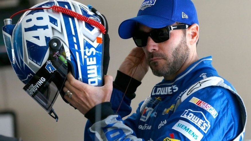 JOLIET, IL - SEPTEMBER 19: Jimmie Johnson, driver of the #48 Lowe's Chevrolet, stands in the garage area during practice for the NASCAR Sprint Cup Series MyAFibRisk.com 400 at Chicagoland Speedway on September 19, 2015 in Joliet, Illinois. (Photo by Jonathan Ferrey/Getty Images)