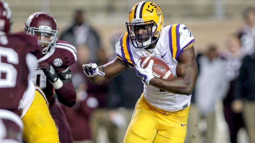 Nov 27, 2014; College Station, TX, USA; LSU Tigers running back Leonard Fournette (7) rushes during the second quarter against the Texas A&M Aggies at Kyle Field. Mandatory Credit: Troy Taormina-USA TODAY Sports