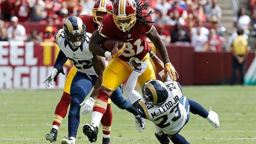 Sep 20, 2015; Landover, MD, USA; Washington Redskins running back Matt Jones (31) carries the ball as St. Louis Rams free safety Rodney McLeod (23) attempts to make the tackle in the second quarter at FedEx Field. The Redskins won 24-10. Mandatory Credit: Geoff Burke-USA TODAY Sports