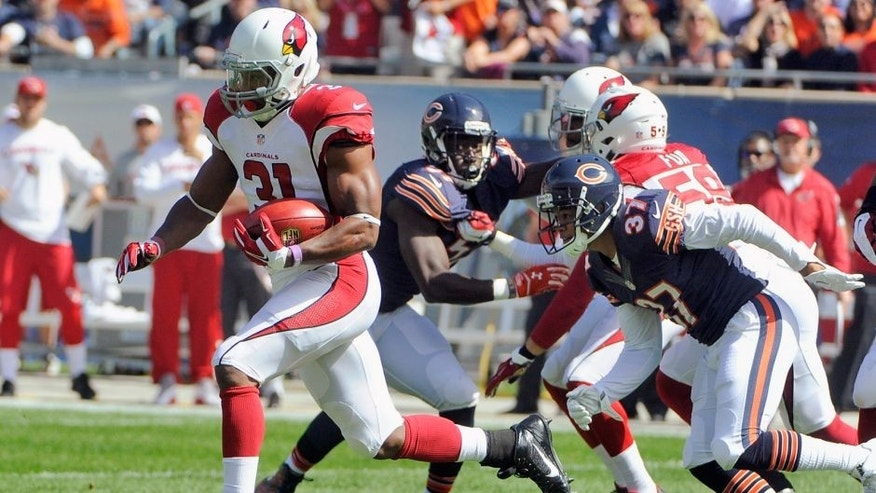 Arizona Cardinals kick returner David Johnson (31) runs the opening kickoff or a touchdown during the first half of an NFL football game against the Chicago Bears, Sunday, Sept. 20, 2015, in Chicago. (AP Photo/David Banks)