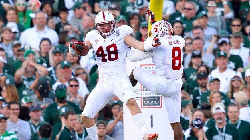 Jan 1, 2014; Pasadena, CA, USA; Stanford Cardinal linebacker Kevin Anderson (48) and safety Jordan Richards (8) celebrate the touchdown against the Michigan State Spartans during the first half at the Rose Bowl. Mandatory Credit: Robert Hanashiro-USA TODAY Sports