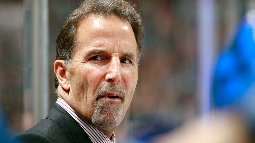 VANCOUVER, BC - NOVEMBER 22: Head coach John Tortorella of the Vancouver Canucks looks on from the bench during their NHL game against the Columbus Blue Jackets at Rogers Arena on November 22, 2013 in Vancouver, British Columbia, Canada. Vancouver won 6-2. (Photo by Jeff Vinnick/NHLI via Getty Images)