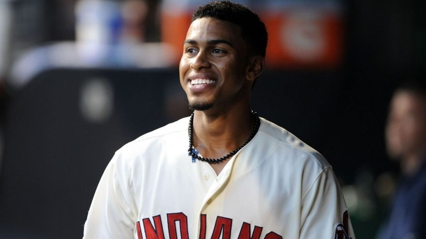 Aug 8, 2015; Cleveland, OH, USA; Cleveland Indians shortstop Francisco Lindor (12) in the dugout after hitting a sacrifice fly during the third inning against the Minnesota Twins at Progressive Field.