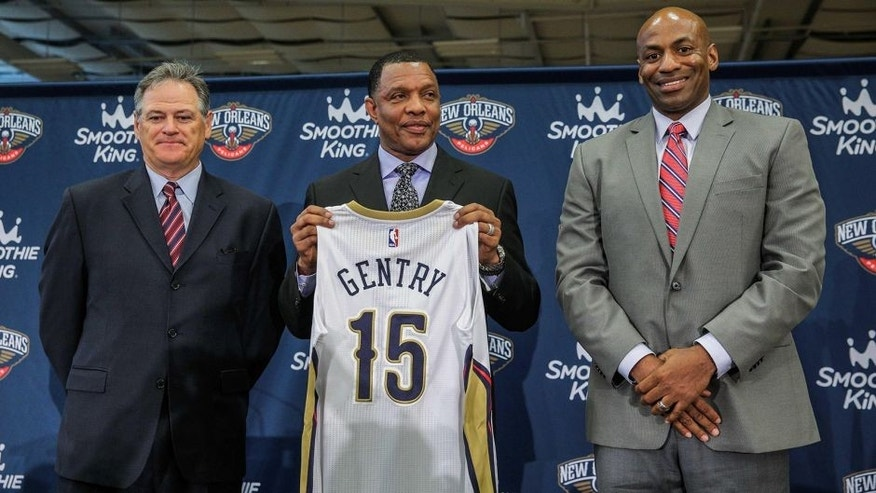 Jun 22, 2015; New Orleans, LA, USA; New Orleans Pelicans head coach Alvin Gentry holds up a jersey with executive vice president Mickey Loomis (left) and general manager Dell Demps (right) during a press conference at the New Orleans Pelicans Training Facility. Mandatory Credit: Derick E. Hingle-USA TODAY Sports