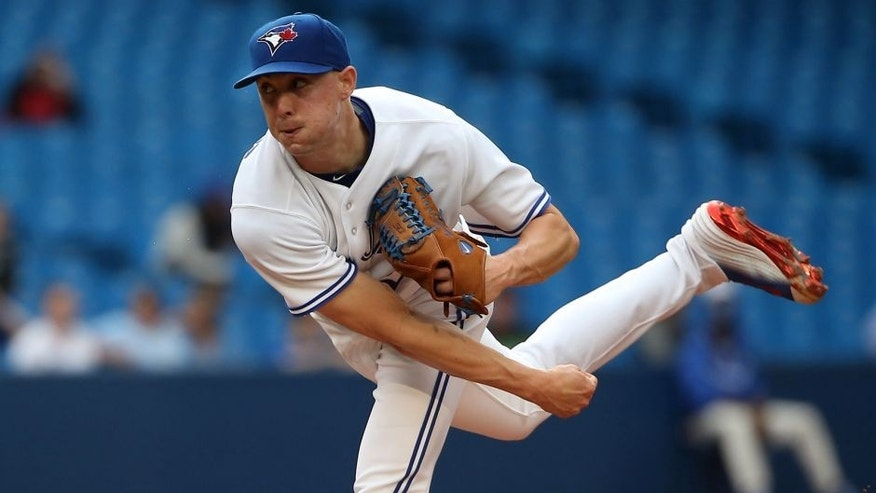 TORONTO, CANADA - JUNE 5: Aaron Sanchez #41 of the Toronto Blue Jays delivers a pitch in the first inning during MLB game action against the Houston Astros on June 5, 2015 at Rogers Centre in Toronto, Ontario, Canada. (Photo by Tom Szczerbowski/Getty Images)