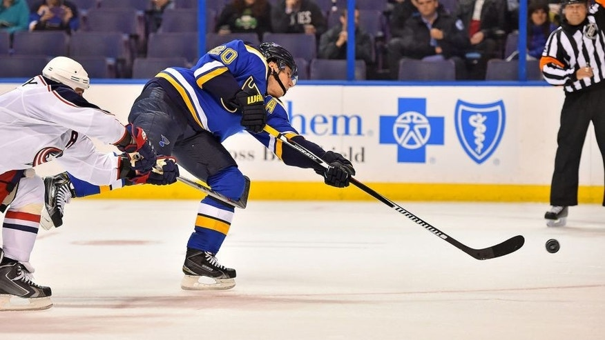 Sep 22, 2015; St. Louis, MO, USA; St. Louis Blues left wing Alexander Steen (20) shoots the puck to score a goal against the Columbus Blue Jackets during the second period at Scottrade Center. Mandatory Credit: Jasen Vinlove-USA TODAY Sports