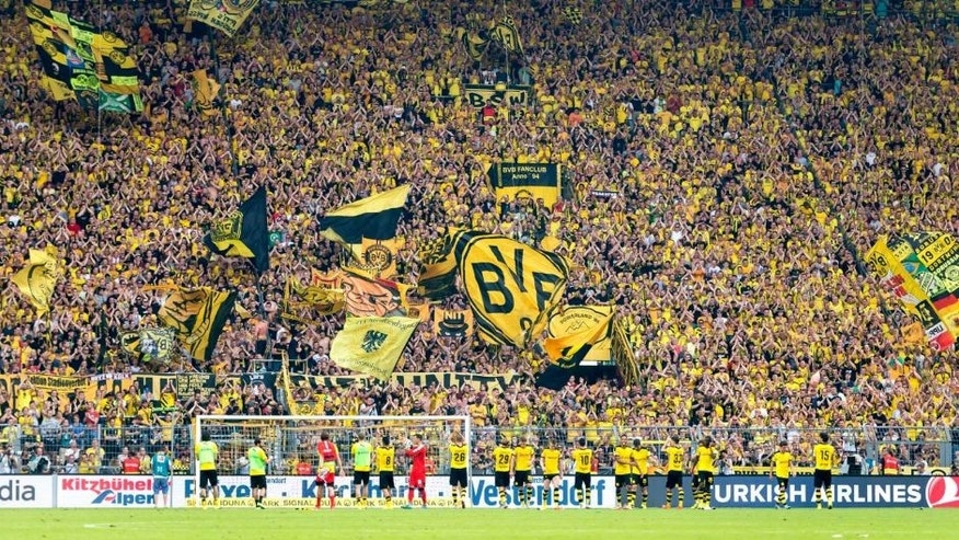 DORTMUND, GERMANY - AUGUST 30: The team of Borussia Dortmund celebrates the win with their fans after the final whistle during the Bundesliga match between Borussia Dortmund and Hertha BSC at Signal Iduna Park on August 30, 2015 in Dortmund, Germany. (Photo by Alexandre Simoes/Borussia Dortmund/Getty Images)