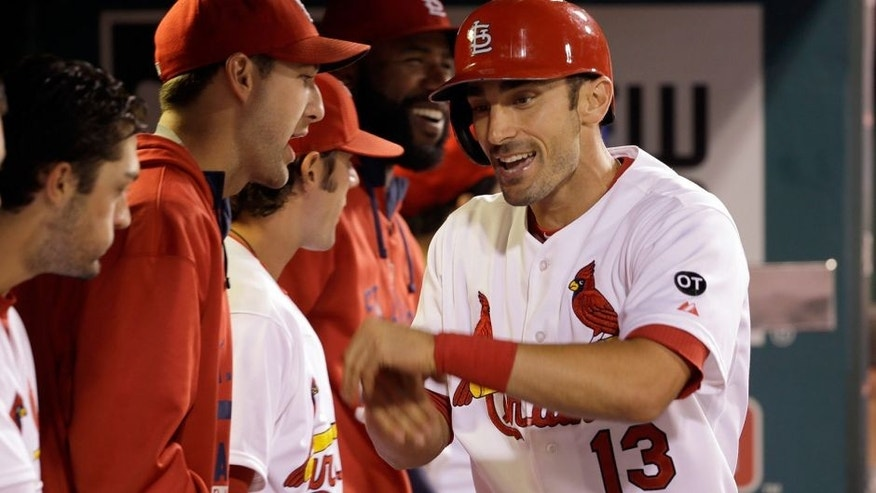 St. Louis Cardinals' Matt Carpenter is congratulated by teammates after hitting his second two-run home run of a baseball game against the Cincinnati Reds, during the fifth inning Wednesday, Sept. 23, 2015, in St. Louis. Carpenter also hit a two-run home run in the third inning. (AP Photo/Jeff Roberson)
