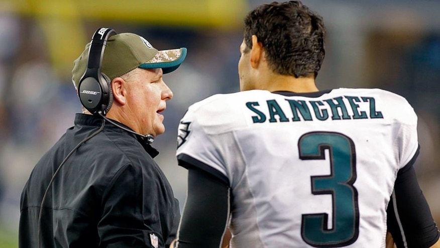 Nov 27, 2014; Arlington, TX, USA; Philadelphia Eagles head coach Chip Kelly talks with quarterback Mark Sanchez (3) on the sidelines during the game against the Dallas Cowboys at AT&T Stadium. Philadelphia beat Dallas 33-10. Mandatory Credit: Tim Heitman-USA TODAY Sports