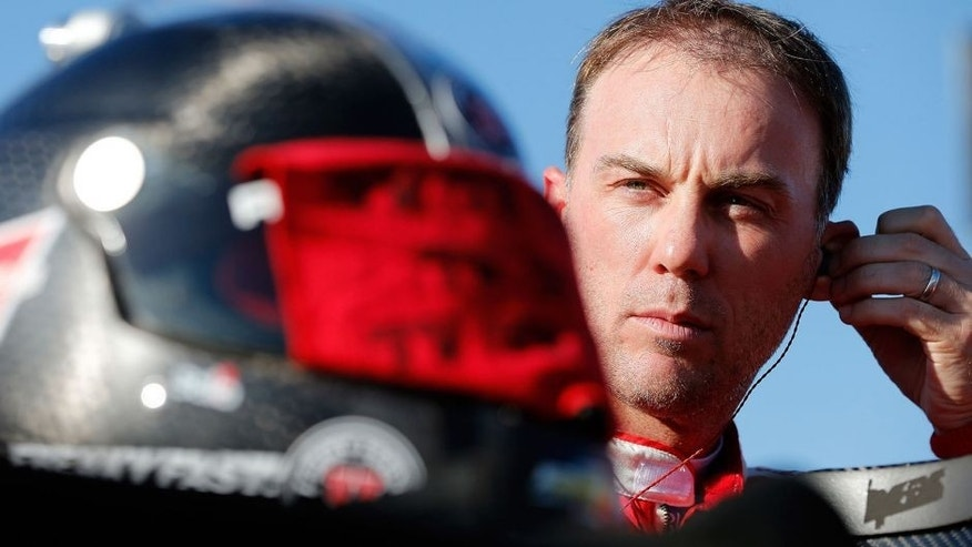 RICHMOND, VA - SEPTEMBER 11: Kevin Harvick, driver of the #4 Budweiser/Jimmy John's Chevrolet, looks on during qualifying for the NASCAR Sprint Cup Series Federated Auto Parts 400 at Richmond International Raceway on September 11, 2015 in Richmond, Virginia. (Photo by Brian Lawdermilk/Getty Images)
