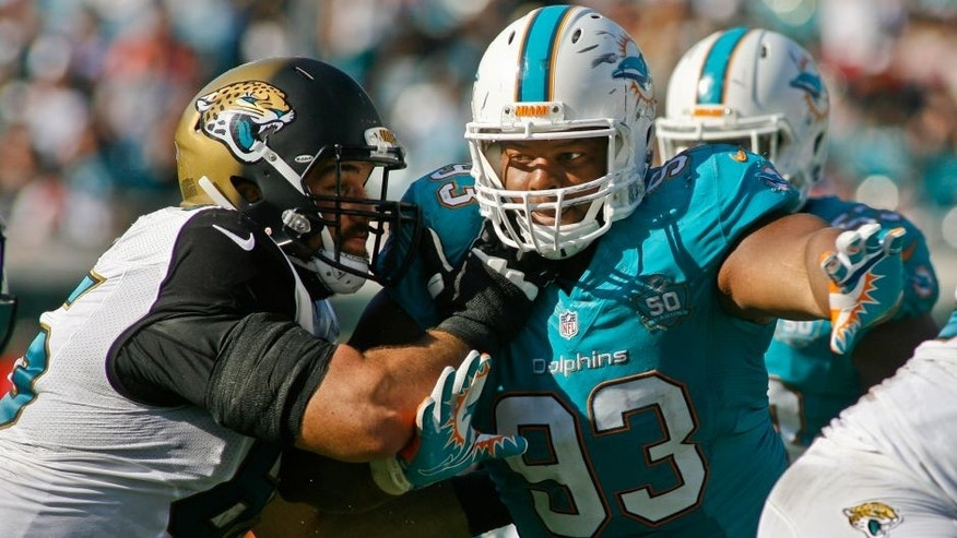 Sep 20, 2015; Jacksonville, FL, USA; Jacksonville Jaguars guard Brandon Linder (65) blocks Miami Dolphins defensive tackle Ndamukong Suh (93) in the second quarter at EverBank Field. Mandatory Credit: Phil Sears-USA TODAY Sports