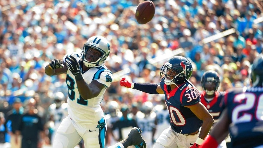 Sep 20, 2015; Charlotte, NC, USA; Carolina Panthers wide receiver Kevin Norwood (81) attempts to catch the ball as Houston Texans cornerback Kevin Johnson (30) defends in the second quarter at Bank of America Stadium. Mandatory Credit: Bob Donnan-USA TODAY Sports