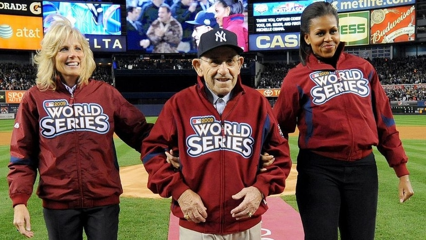 <p>NEW YORK - OCTOBER 28: Dr. Jill Biden, Yogi Berra and first lady Michelle Obama are seen on the field during pre-game ceremonies prior to Game 1 of the 2009 World Series between the Philadelphia Phillies and the New York Yankees at Yankee Stadium October 28, 2009 in New York City. (Photo by Rich Pilling/MLB Photos via Getty Images)</p>