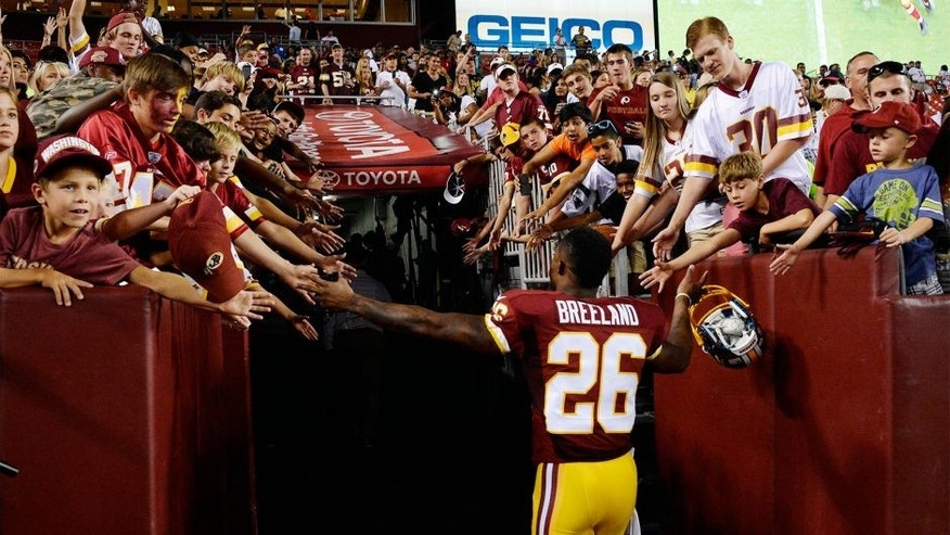 Aug 7, 2014; Landover, MD, USA; Washington Redskins cornerback Bashaud Breeland (26) greets fans after the game against the New England Patriots at FedEx Field. The Redskins won 23-6. Mandatory Credit: Rafael Suanes-USA TODAY Sports
