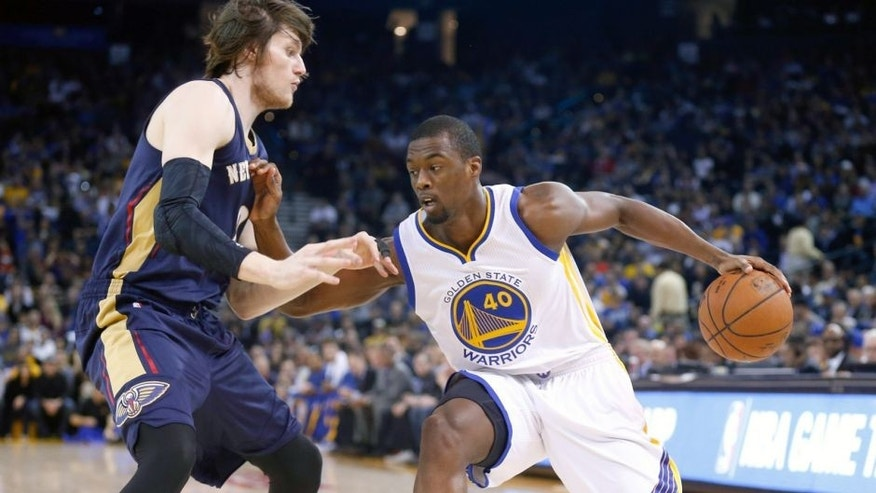 Dec 4, 2014; Oakland, CA, USA; Golden State Warriors forward Harrison Barnes (40) drives in against New Orleans Pelicans forward Luke Babbitt (8) during the first quarter at Oracle Arena. Mandatory Credit: Kelley L Cox-USA TODAY Sports