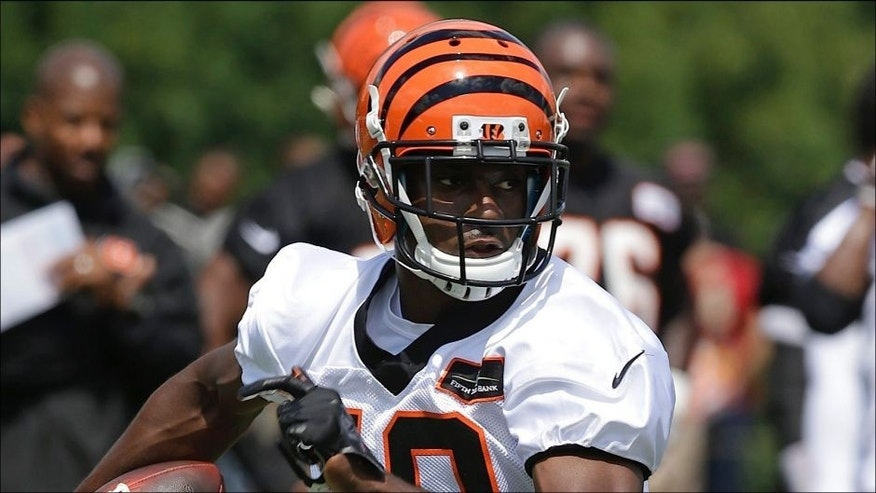 <p>Cincinnati Bengals wide receiver A.J. Green runs an end-around during the NFL football team's first practice at training camp on Thursday, July 24, 2014, in Cincinnati. (AP Photo)</p>