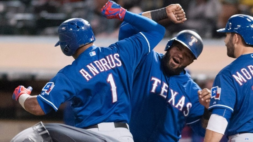 Sep 23, 2015; Oakland, CA, USA; Texas Rangers shortstop Elvis Andrus (1) and designated hitter Prince Fielder (84) celebrate after Elvis hit a three run home run against the Oakland Athletics during the fourth inning at O.co Coliseum. Mandatory Credit: Ed Szczepanski-USA TODAY Sports