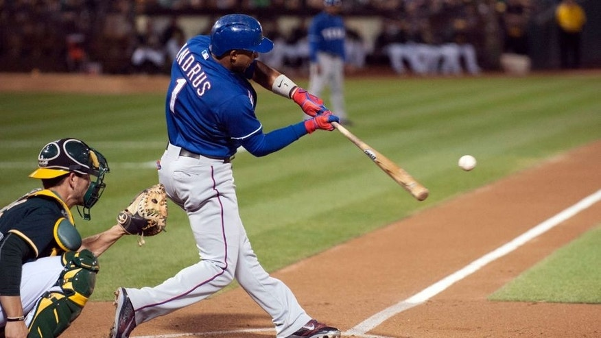 Sep 23, 2015; Oakland, CA, USA; Texas Rangers shortstop Elvis Andrus (1) hits a double against the Oakland Athletics during the second inning at O.co Coliseum. Mandatory Credit: Ed Szczepanski-USA TODAY Sports