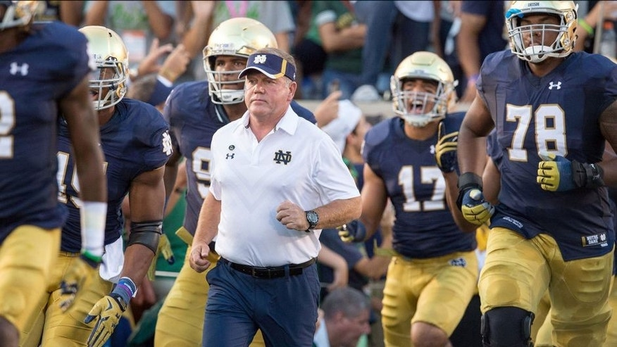 Sep 5, 2015; South Bend, IN, USA; Notre Dame Fighting Irish head coach Brian Kelly runs onto the field before the game against the Texas Longhorns at Notre Dame Stadium. Notre Dame won 38-3. Mandatory Credit: Matt Cashore-USA TODAY Sports