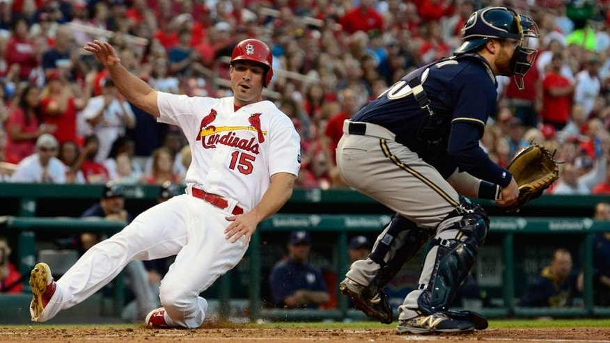Jun 2, 2015; St. Louis, MO, USA; St. Louis Cardinals right fielder Randal Grichuk (15) slides safely past Milwaukee Brewers catcher Jonathan Lucroy (20) during the second inning at Busch Stadium. Mandatory Credit: Jeff Curry-USA TODAY Sports