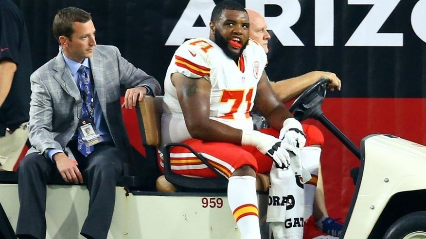 Aug 15, 2015; Glendale, AZ, USA; Kansas City Chiefs offensive lineman Jeff Allen (71) is taken off the field on a medical cart with a trainer after suffering an injury against the Arizona Cardinals during a preseason NFL football game at University of Phoenix Stadium. Mandatory Credit: Mark J. Rebilas-USA TODAY Sports