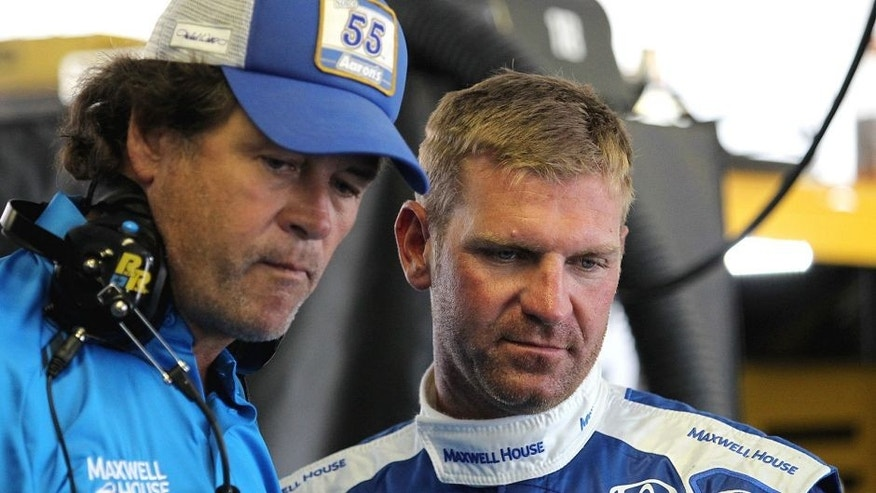 LONG POND, PA - JULY 31: Clint Bowyer, driver of the #15 Maxwell House Toyota, right, talks with team owner Michael Waltrip in the garage area during practice for the NASCAR Sprint Cup Series Windows 10 400 at Pocono Raceway on July 31, 2015 in Long Pond, Pennsylvania. (Photo by Tim Bradbury/Getty Images)