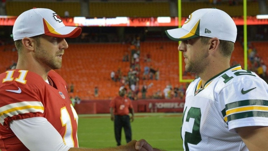 Aug 29, 2013; Kansas City, MO, USA; Kansas City Chiefs quarterback Alex Smith (11) talks with Green Bay Packers quarterback Aaron Rodgers (12) after the game at Arrowhead Stadium. The Chiefs won 30-8. Mandatory Credit: Denny Medley-USA TODAY Sports
