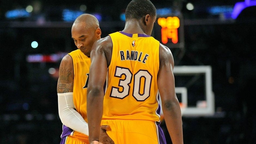 October 19, 2014; Los Angeles, CA, USA; Los Angeles Lakers guard Kobe Bryant (24) reacts with forward Julius Randle (30) after a foul is drawn against the Utah Jazz during the second half at Staples Center. Mandatory Credit: Gary A. Vasquez-USA TODAY Sports