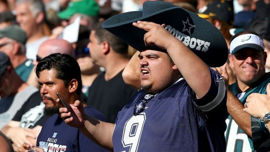 PHILADELPHIA, PA - SEPTEMBER 20: A Dallas Cowboys fan cheers on his team in the first quarter against the Philadelphia Eagles on September 20, 2014 at Lincoln Financial Field in Philadelphia, Pennsylvania. (Photo by Elsa/Getty Images)