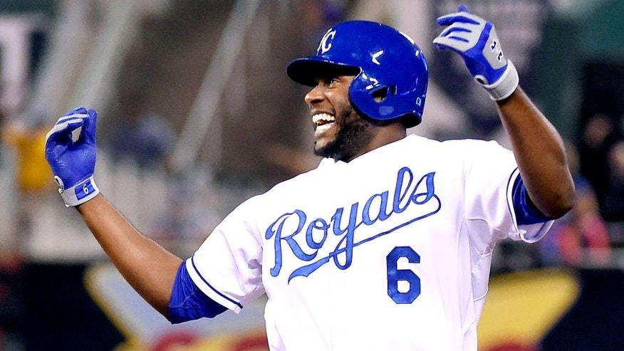 The Kansas City Royals' Lorenzo Cain (6) celebrates after hitting the winning run to score Paulo Orlando in the 10th inning against the Seattle Mariners on Wednesday, Sept. 23, 2015, at Kauffman Stadium in Kansas City, Mo. The Royals won, 4-3, in 10 innings. (John Sleezer/Kansas City Star/TNS via Getty Images)