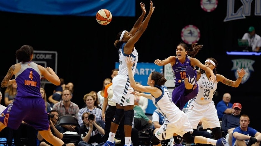 <p>Phoenix Mercury guard Marta Xargay (10) tries to pass the ball to teammate forward Candice Dupree (4) during the first half of Game 1 of the WNBA basketball Western Conference finals against the Minnesota Lynx, Thursday, Sept. 24, 2015, in Minneapolis. (AP Photo/Stacy Bengs)</p>