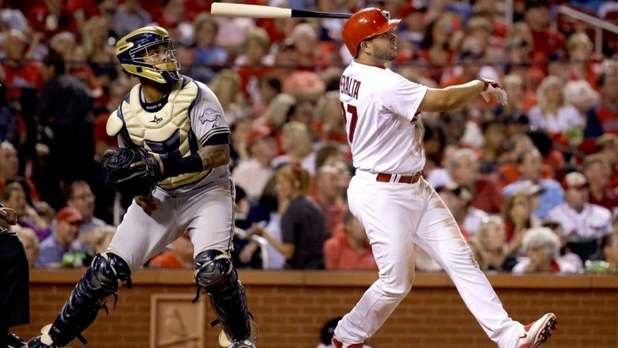 <p>St. Louis Cardinals' Jhonny Peralta, right, watches his three-run home run along side Milwaukee Brewers catcher Martin Maldonado during the fourth inning of a baseball game on Thursday, Sept. 24, 2015, in St. Louis. (AP Photo/Jeff Roberson)</p>