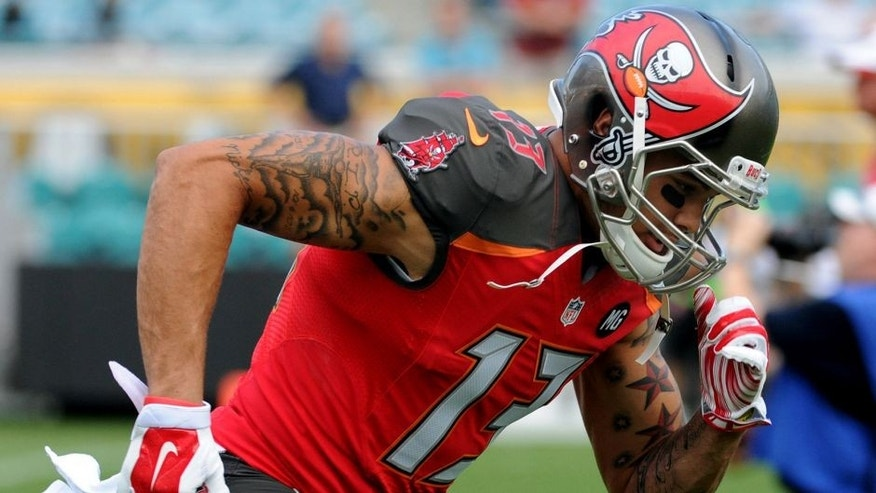 Aug 8, 2014; Jacksonville, FL, USA; Tampa Bay Buccaneers wide receiver Mike Evans (13) warms up prior to the preseason game against the Jacksonville Jaguars at EverBank Field. Mandatory Credit: Melina Vastola-USA TODAY Sports